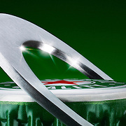 Heineken bottle cap and bottle opener suggesting to be the arch over Wembley Stadium Ray Massey is an established, award winning, UK professional  photographer, shooting creative advertising and editorial images from his stunning studio in a converted church in Camden Town, London NW1. Ray Massey specialises in drinks and liquids, still life and hands, product, gymnastics, special effects (sfx) and location photography. He is particularly known for dynamic high speed action shots of pours, bubbles, splashes and explosions in beers, champagnes, sodas, cocktails and beverages of all descriptions, as well as perfumes, paint, ink, water – even ice! Ray Massey works throughout the world with advertising agencies, designers, design groups, PR companies and directly with clients. He regularly manages the entire creative process, including post-production composition, manipulation and retouching, working with his team of retouchers to produce final images ready for publication.