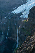 """Multiple waterfalls plunge from Castaño Overo Glacier on Cerro Tronador, an extinct stratovolcano in the southern Andes, near Bariloche, in the Lake District of Argentina, in Patagonia, South America. The sound of falling seracs inspired the name Tronador, Spanish for """"Thunderer."""" With an altitude of 3470 m, Tronador stands more than 1000 meters above nearby mountains in the Andean massif, making it a popular climb in Patagonia, South America. Located inside two National Parks, Nahuel Huapi in Argentina and Vicente Pérez Rosales in Chile, Tronador hosts eight glaciers, which are retreating due to warming of the upper troposphere."""