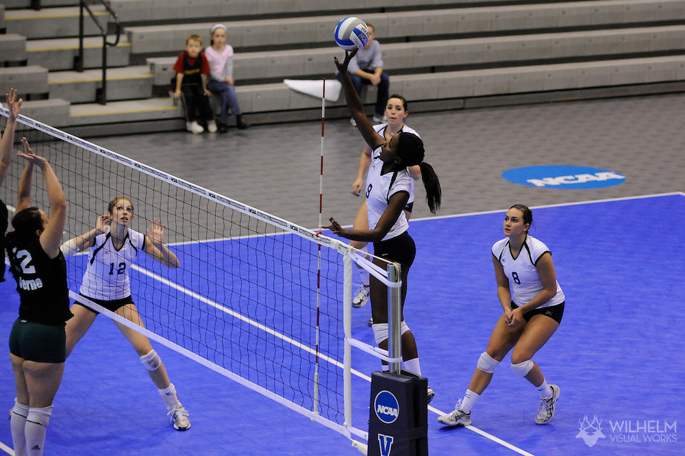 22 NOV 2008:  Amelia McCall (9) of Emory University goes up for a hit during 2008 NCAA Women's Division III Volleyball Championship held at the Shirk Center on the campus of Illinois Wesleyan University in Bloomington, IL. Emory defeated La Verne 3-1 for the national title. © Brett Wilhelm