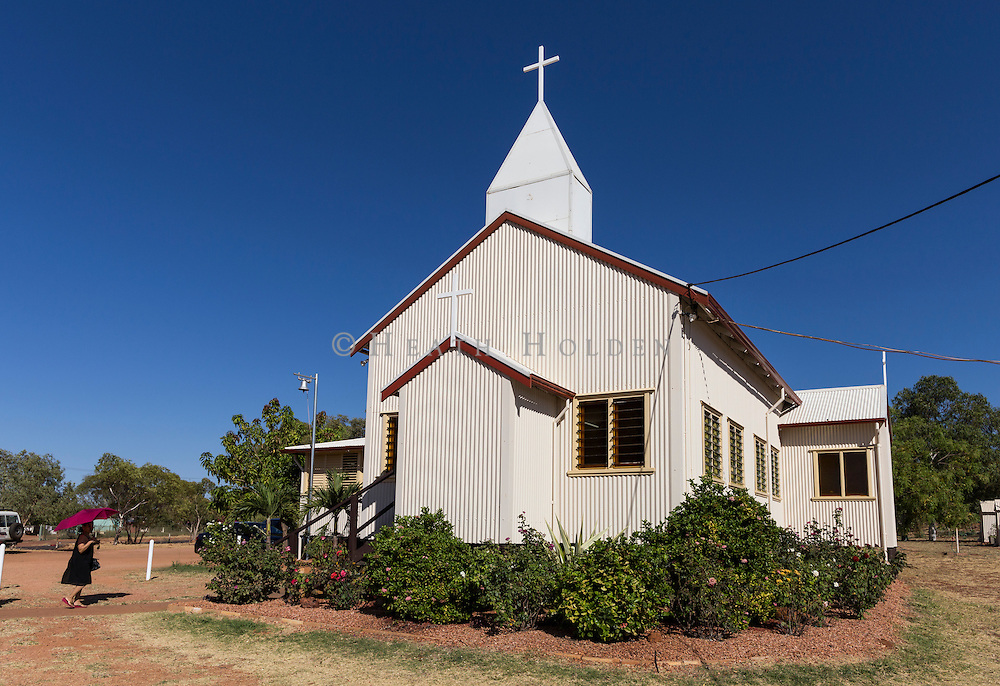 Locals arrive at the Tennant Creek baptist church for the Sunday morning service.