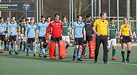 WASSENAAR - opkomst teams met scheidsrechters Coen van Bunge en Karin Dolle,  tijdens de hoofdklasse competitiewedstrijd heren, HGC-HC ROTTERDAM (0-7) .     COPYRIGHT  KOEN SUYK