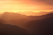 A spectacular sunrise for the first day of summer. A forest fire 50 miles away  brings haze to the mountains of the Tenmile Range as viewed at sunrise from the summit of Notch Mountain near Miniturn, Colorado.