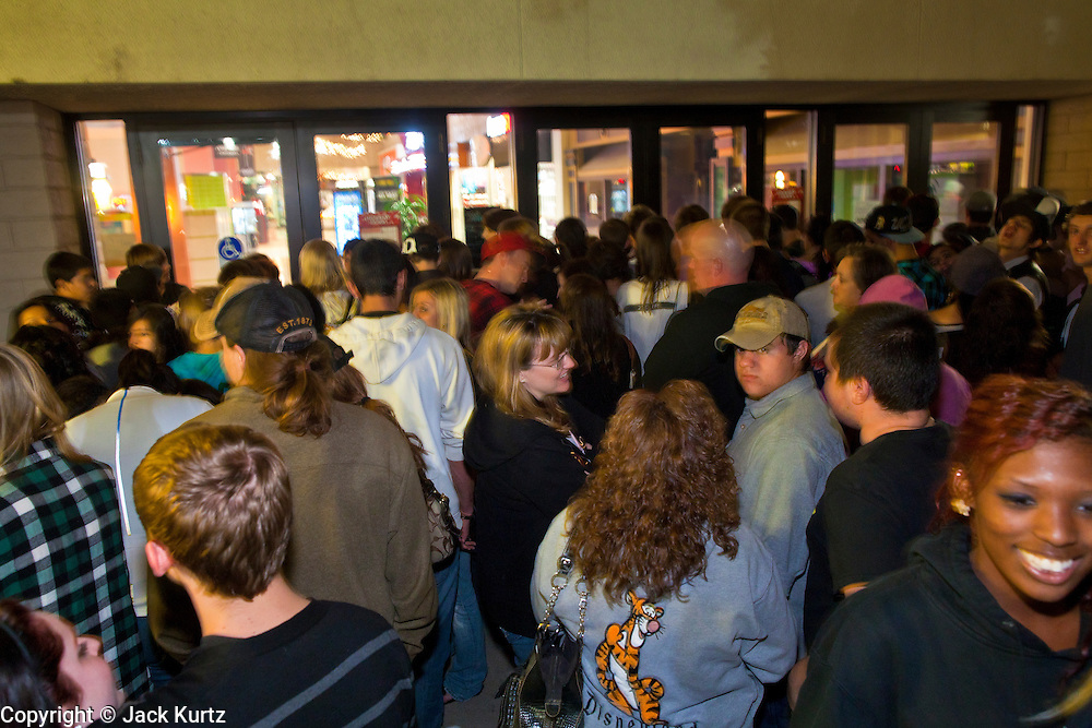 """24 NOVEMBER 2011 - PHOENIX, AZ:  People wait to get into Paradise Valley Mall Thursday. """"Black Friday,"""" the unofficial start of the holiday shopping season started even earlier than normal. Many stores, including Target and Best Buy, opened at midnight.    Photo by Jack Kurtz"""