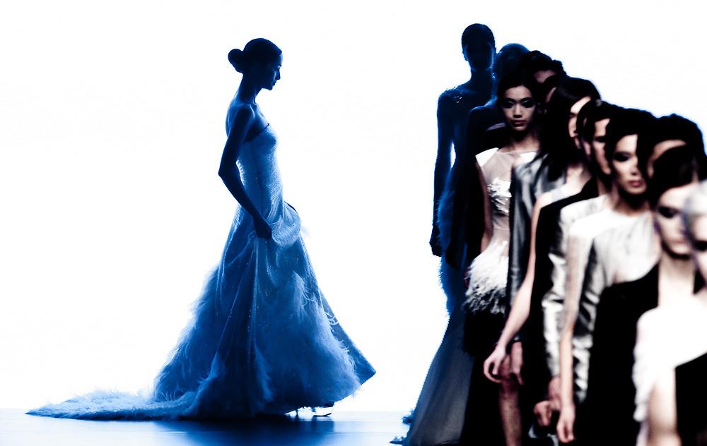 HONG KONG - JANUARY 17:  Models showcase designs by Alex Wang of China during the 'Extravaganza' show as part of the Hong Kong Fashion Week Fall/Winter on January 17, 2011 in Hong Kong, China.  Photo by Victor Fraile / studioEAST