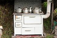 Tea boiling on the stove at Kujtim Gocaj Guesthouse, Çeremi, Peaks of the Balkans trail, Albania © Rudolf Abraham