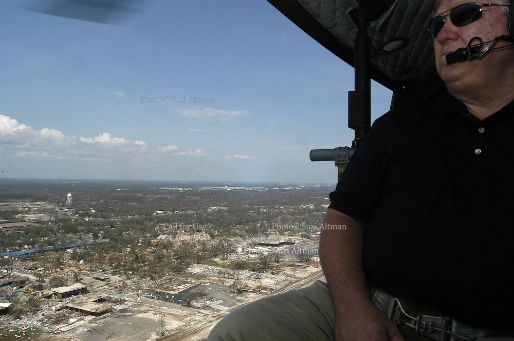 Mississippi Governor Haley Barbour gets a ride in a huey helicopter to survey the damage along the gulf coast sunday sept. 4,2005. The governor brought baby supplies and water to bay St. Louis High School on of the hardest hit communities.(photo/Suzi Altman)