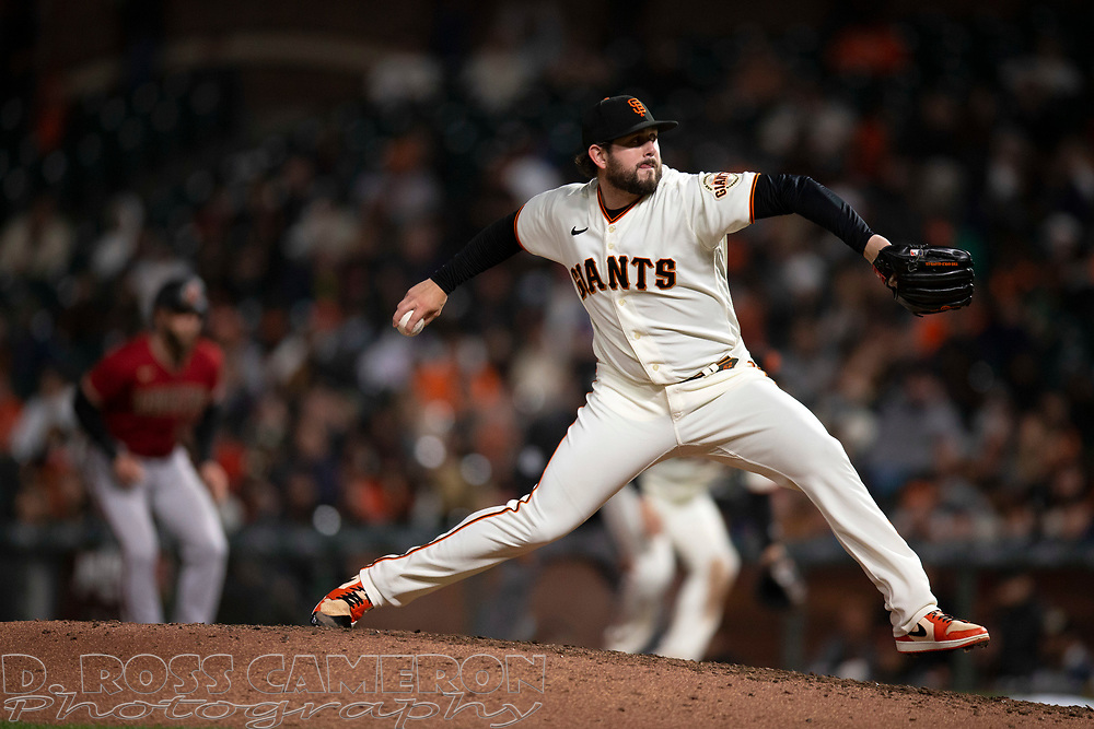 Sep 29, 2021; San Francisco, California, USA; San Francisco Giants pitcher Dominic Leone (52) delivers a pitch against the Arizona Diamondbacks during the seventh inning at Oracle Park. Mandatory Credit: D. Ross Cameron-USA TODAY Sports