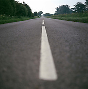 An empty country road with white road markers on the 29th June 2008 in Yeovil in the United Kingdom.
