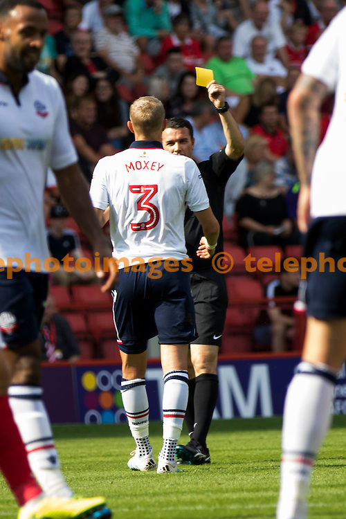 Bolton defender Dean Moxey is booked during the Sky Bet League 1 match between Charlton Athletic and Bolton Wanderers at The Valley in London. August 27, 2016.<br /> Sam Falaise / Telephoto Images<br /> +44 7967 642437
