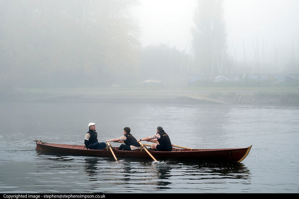 © Licensed to London News Pictures. 01/11/2015. Kingston, UK. Boats and canoes make their way through the fog.  Fog along the River Thames in Kingston today, 1st November 2015. Much of the South East of Britain woke to fog this morning. Photo credit : Stephen Simpson/LNP