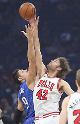 November 3, 2017 - Orlando, FL, USA - The Orlando Magic's Nikola Vucevic (9) and the Chicago Bulls' Robin Lopez (42) tip off to start the game at the Amway Center in Orlando, Fla., on Friday, Nov. 3, 2017. (Credit Image: © Stephen M. Dowell/TNS via ZUMA Wire)