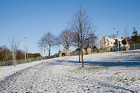 Snow covered Kilbogget Park in suburban in Dublin Ireland