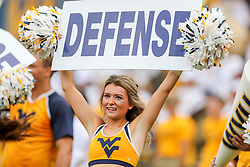 Sep 14, 2019; Morgantown, WV, USA; A West Virginia Mountaineers cheerleader performs during the first quarter against the North Carolina State Wolfpack at Mountaineer Field at Milan Puskar Stadium. Mandatory Credit: Ben Queen-USA TODAY Sports