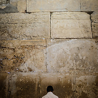 Jewish men pray at the Western Wall in Jerusalem.