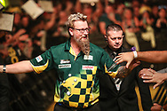 Simon Whitlock walk on during the 2018 Grand Slam of Darts at Aldersley Leisure Village, Wolverhampton, United Kingdom on 16 November 2018. Picture by Shane Healey.