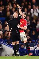 Phill Jones of Manchester Utd is shown a yellow card by referee Anthony Taylor  .Premier league match, Chelsea v Manchester United at Stamford Bridge in London on Sunday 5th November 2017.<br /> pic by Andrew Orchard sports photography.