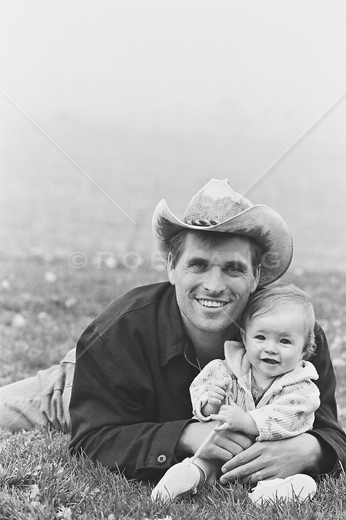 portrait of man with baby