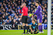 Lee Mason (Referee) & Jonathan Bond (GK) (West Brom) with Sam Field (West Brom) who is injured during the FA Cup fourth round match between Brighton and Hove Albion and West Bromwich Albion at the American Express Community Stadium, Brighton and Hove, England on 26 January 2019.
