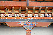Carved and painted timbers in the colonnade surrounding the courtyard of  Wangdue Phrodrang Dzong.  Wangdue Phrodrang Dzong. Buhtan, Druk Yul.  14 November 2006