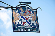 Close up of old metal pub sign sign for Arkells brewers, Calne, Wiltshire, England