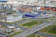 Nederland, Noord-Holland, Amsterdam-Zuidoost, 16-04-2008; Bullewijk, diagonaal rechtsonder de Gaasperdammerweg (A9), linksonder McDonald's en Shell benzine staion; middenplan een vestiging van IKEA omgeven door kantoorgebouwen; de de achtergrond de klassieke flats van de Bijlmermeer; MacDonald, MacDonald, MacDonald's..luchtfoto (toeslag); aerial photo (additional fee required); .foto Siebe Swart / photo Siebe Swart