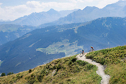 Elevated view of mountain bikers riding on uphill, Zillertal, Tyrol, Austria