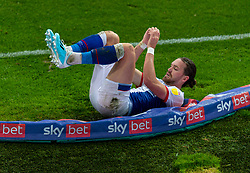 BLACKBURN, ENGLAND - Saturday, October 3, 2020: Blackburn Rovers' Sam Gallagher collapses into the advertising hoardings during the Football League Championship match between Blackburn Rovers FC and Cardiff City FC at Ewood Park. The game ended in a 0-0 draw. (Pic by David Rawcliffe/Propaganda)
