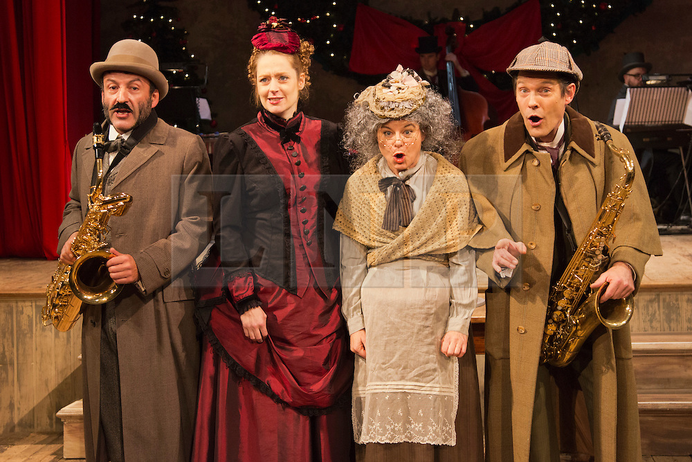 """© Licensed to London News Pictures. 28/11/2014. London, England. L-R: Toby Aitor Basauri, Petra Massey, Toby Park and Sophie Russell. Spymonkey company present """"Mrs Hudson's Christmas Corker! Or 'Your Goose is Cooked Mr Holmes' ..."""" at Wilton's Music Hall, London. Written by Barry and Boy Cryer, the Christmas show takes place at 221B Baker Street with a tale based on the Sherlock Holmes legend by Sir Arthur Conan Doyle. Performances from 2 to 31 December 2014. With actors: Aitor Basauri (Dr Watson), Petra Massey (Mrs Hudson), Toby Park (Sherlock Holmes) and Sophie Russell. Photo credit: Bettina Strenske/LNP"""