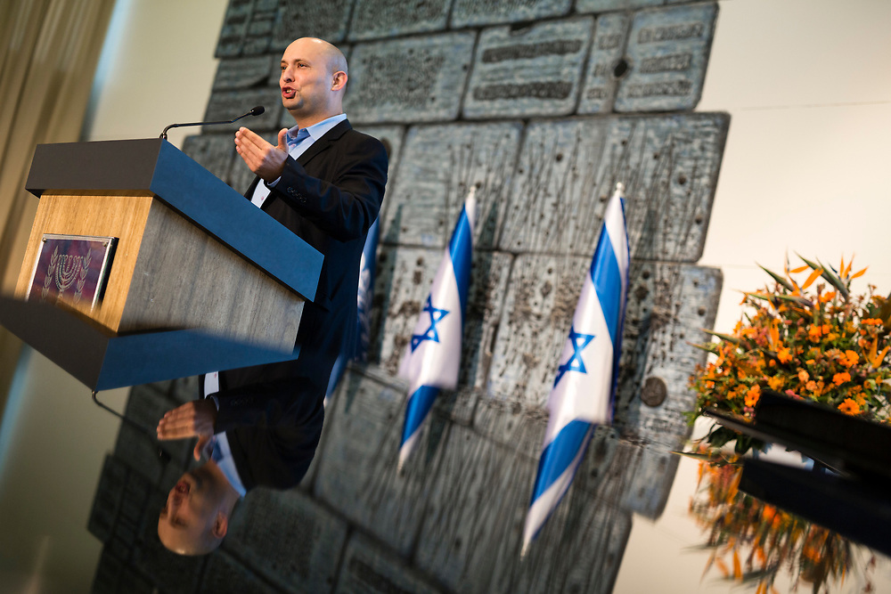 Israeli Economy Minister and head of the ultra-nationalist party Jewish Home, Naftali Bennett gestures as he speaks during the annual awards ceremony for outstanding exporters at the President's Residence in Jerusalem, Israel, on December 24, 2014.