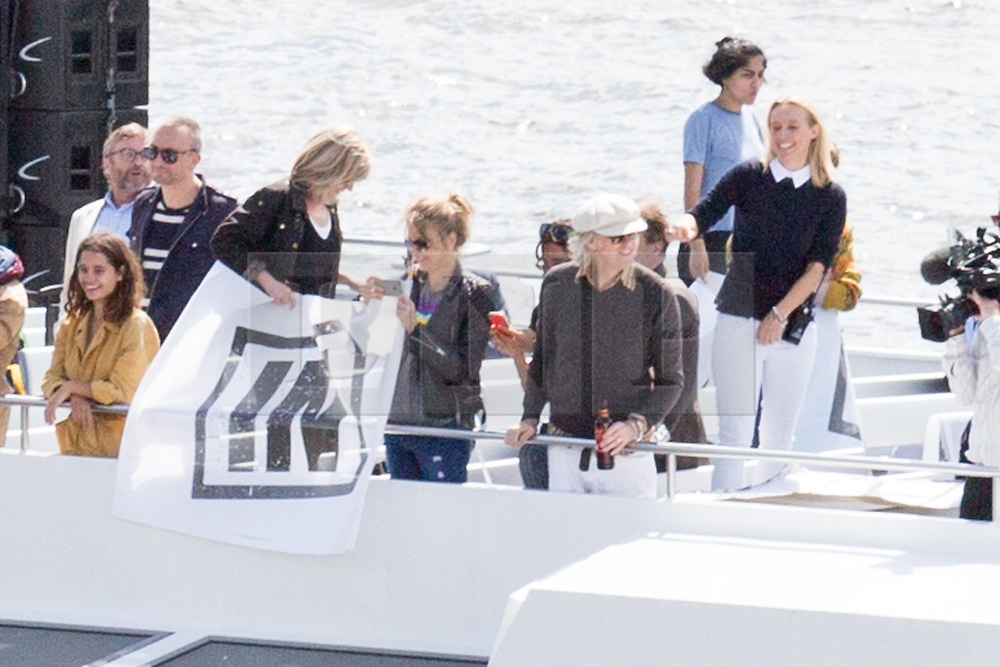 """© Licensed to London News Pictures. 15/06/2016. London, UK. Bob Geldof demonstrates on the """"Vote In' boat as the pro-Brexit campaign 'Fishermen for Leave', sail a flotilla of over 30 vessels up the Thames. The flotilla, including UKIP leader Nigel Farage, caused traffic issues in central London, as vessels travelled up the Thames for high tide and to coincide with the last Prime Minister's Questions before the EU referendum takes place on 23 June. Photo credit : Tom Nicholson/LNP"""