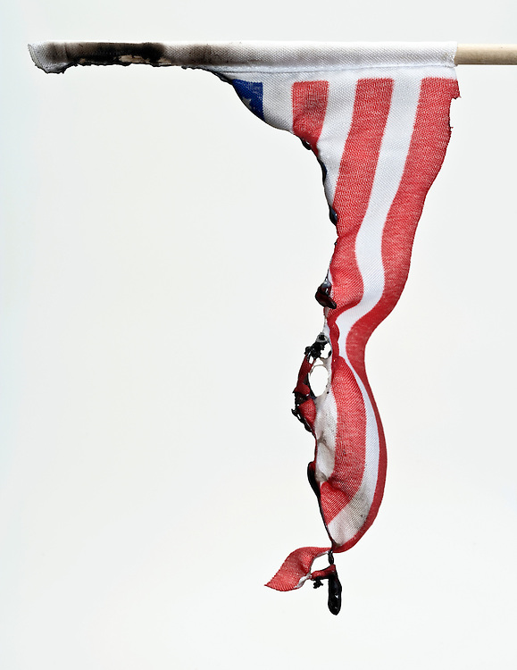 burned American flag against a white background