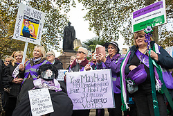 London, UK. 5 November, 2019. Campaigners from WASPI (Women Against State Pension Inequality), standing next to a Guy Fawkes figure disguised as Guy Opperman, protest in Parliament Square to call for fair transitional pension arrangements for women born in the 1950s affected by the changes to the State Pension Age (SPA), including a 'bridging' pension to provide an income from age 60 until State Pension Age and recompense for losses incurred by women who have already reached their SPA.