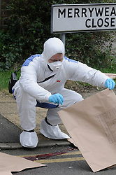 © Licensed to London News Pictures.13/02/2013. Dartford. Kent. A forensic investigation ha begun after a 32 year old man was shot dead in Dartford last night (12/02/2013). The police have set up a cordon in Merryweather Close this morning.The victim has been named locally as Kevin Mckinley from Stone. Police have arrested a man and woman.People have been arriving at the scene to lay flowers. Photo credit : Grant Falvey/LNP