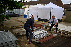 © Licensed to London News Pictures. 16/05/2017. London, UK. A shed being dismantled by a search team, at the scene where police continue to search for the body of murdered schoolgirl Danielle Jones at a block of garages in Stifford Clays in Thurrock, Essex. The 15-year-old was last seen on Monday June 18 2001 at about 8am when she left her home in East Tilbury to catch the bus to school.  Photo credit: Ben Cawthra/LNP
