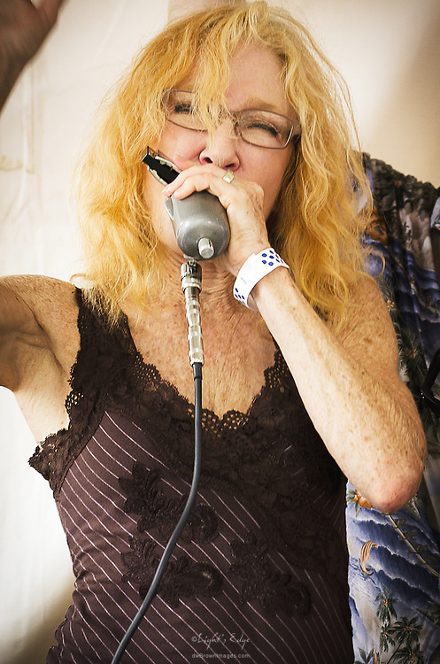 Carol Moog working the harmonica while performing with Garry Cogdell & friends at the Riverfront Blues Festival in Wilmington, DE.