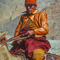A merchant from Mustang rides his horse in the Kali Gandaki Valley, Nepal.