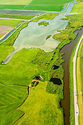 Nederland, Noord-Holland,  Gemeente Medemblik, 05-08-2014; Kadetjesland, oud cultuurlandschap, niet verkaveld. Gelegen pal naast de Wieringermeer, ten westen van Opperdoes.<br /> Ancient cultivated land, not parceled.<br /> luchtfoto (toeslag op standard tarieven);<br /> aerial photo (additional fee required);<br /> copyright foto/photo Siebe Swart