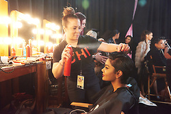 December 8, 2019, Atlanta, Georgia, USA: Mohanaprabha Selvam, Miss Singapore 2019 gets hair done by a stylist from Farouk Systems, the Makers of CHI & Biosilk backstage during The Miss Universe Competition telecast, held at Tyler Perry Studios. Contestants from around the globe have spent the last few weeks touring, filming, rehearsing and preparing to compete for the Miss Universe crown. (Credit Image: © Benjamin Askinas/Miss Universe Organization via ZUMA Wire)
