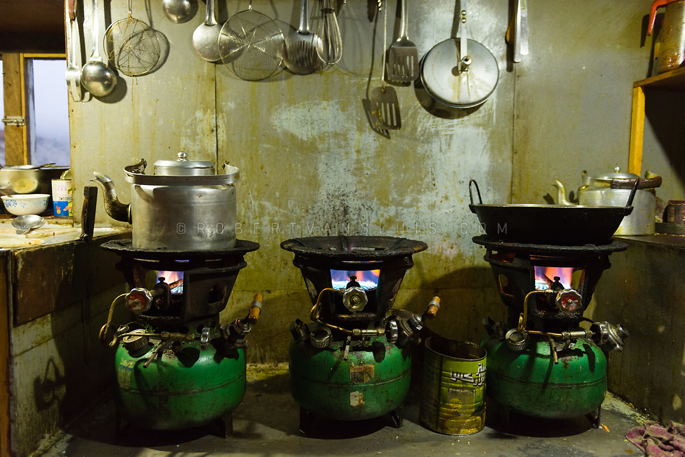 Cooking on bottled gas in a trekking lodge in Dzongla, Nepal Himalaya. Photo © robertvansluis.com