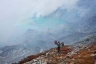 This worker is returning to the sulfur pits at the bottom of the volcanic crater on Mt Ijen, Java, Indonesia.