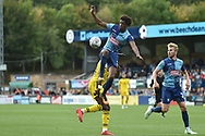 Wycombe Wanderers defender Sido Jambati (2) gets up high to defend during the EFL Sky Bet League 1 match between Wycombe Wanderers and Oxford United at Adams Park, High Wycombe, England on 15 September 2018.