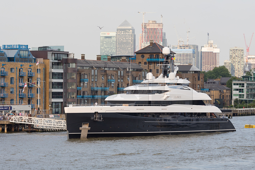 © Licensed to London News Pictures. 04/07/2018. London, UK.  The new 243 feet long superyacht, Elandess arrives in London for the first time ever on the River Thames and moors  at HMS President, the Royal Navy Reserve Unit next to St Katharine Docks and Tower Bridge this evening. Elandess was built at the Abeking and Rasmussen shipyard in Germany, launched in May 2018 and has just completed sea trials ahead of its London visit. Elandess has an axe-bow, dark hull and low-slung superstructure. There are a variety of entertaining communal spaces, from the 8 x 2.5-metre superyacht swimming poollocated on the massive sun deckto the Nemo Loungewith portholesbelow the waterline and an observation lounge on the upper deck. Guest accommodation includes six staterooms, including the master suitewhich is placed forward on the main deck with an observation lounge directly above on the upper deck.  Photo credit: Vickie Flores/LNP