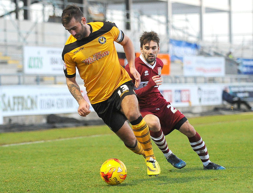 Newport County's Andy Sandell under pressure from Northampton Town's Ricky Holmes<br /> <br /> Photographer Kevin Barnes/CameraSport<br /> <br /> Football - The Football League Sky Bet League Two - Northampton Town v Newport County AFC - Saturday 24rd January 2015 - Sixfields Stadium - Northampton<br /> <br /> © CameraSport - 43 Linden Ave. Countesthorpe. Leicester. England. LE8 5PG - Tel: +44 (0) 116 277 4147 - admin@camerasport.com - www.camerasport.com