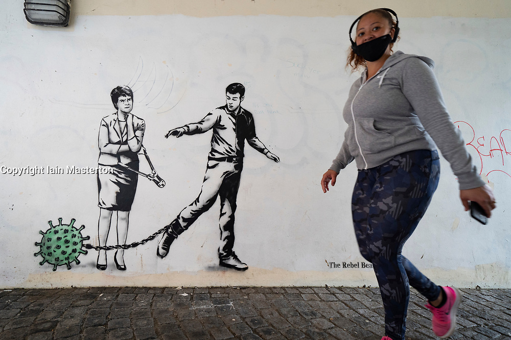 Edinburgh, Scotland, UK. 10 June 2021. An new mural by artist The Rebel Bear has appeared in Edinburgh featuring First Minister Nicola Sturgeon wielding bolt cutters and standing beside a man shackled to the coronavirus..  Iain Masterton/Alamy Live News
