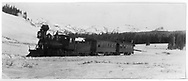 """RGS 2-8-0 #9 on Jackson's special photographic train below Lizard Head Peak viewpoint approaching Gallagher.<br /> RGS  s. of Lizard Head Pass, CO  Taken by Jackson, William Henry - 1/9/1892<br /> In book """"RGS Story, The Vol. IV: Over the Bridges? Ophir Loop to Rico"""" page 333<br /> See RD155-049 for enlargement.<br /> Also in """"Mixed Train Daily"""", p. 151; """"Silver San Juan"""", pp. 96-97 and """"Vanishing Varnish"""", p. 237."""