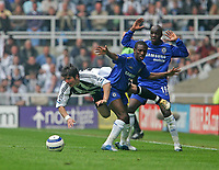 Photo: Andrew Unwin.<br /> Newcastle United v Chelsea. The Barclays Premiership. 07/05/2006.<br /> Newcastle's Emre (L) is fouled by Chelsea's Shaun Wright-Phillips (C).