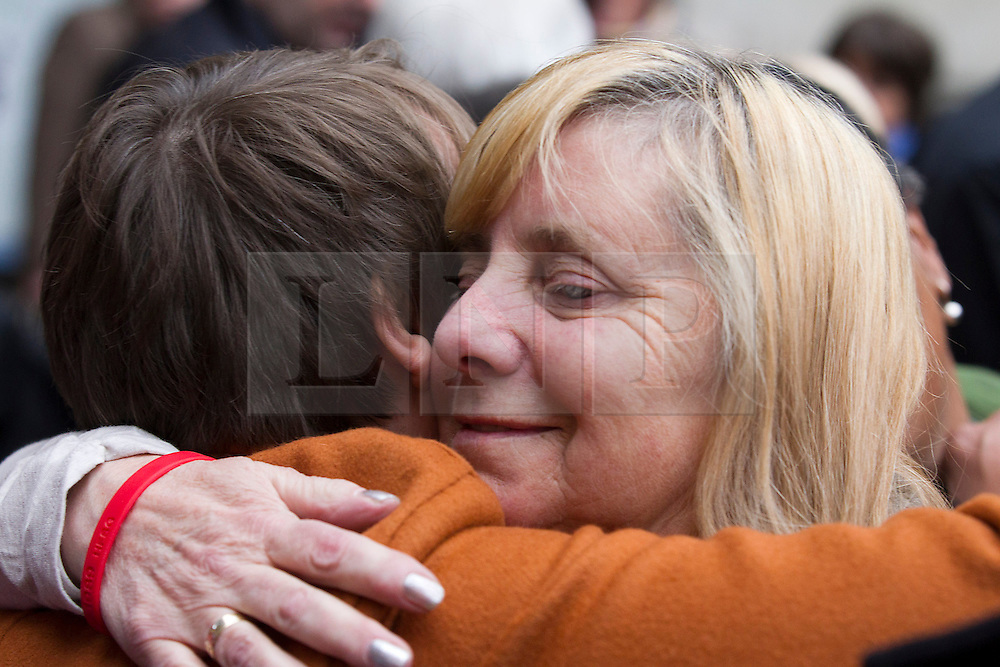 © Licensed to London News Pictures. 19/12/2012. London, UK. Margaret Aspinal (R) hugs a well-wisher outside outside the Royal Courts of Justice in London after the original accidental death ruling on the 1989 Hillsborough disaster was quashed by a judge today 19/12/12). The ruling on the disaster, in which 96 football fans were crushed to death during an FA Cup semi final between Liverpool and Nottingham Forest, opens the way for a new inquest. Photo credit: Matt Cetti-Roberts/LNP