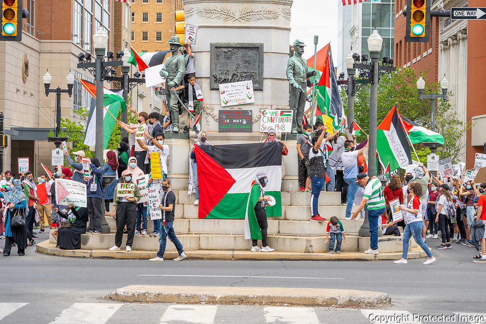 Protesters gather at the war memorial in downtown Allentown, Pennsylvania for a Palestine solidarity rally. Police estimated the crowd at over 200 people.