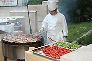 Male Chef at a large outdoor barbeque