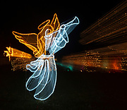 Zooming a lens during a time exposure causes this effect in this photo of an angel at the Way of Lights holiday light display at the National Shrine of Our Lady of the Snows in Belleville on December 3, 2019. This is the 50th anniversary of the annual light display, which runs from 5 pm to 9 pm through December 31.<br />Photo by Tim Vizer